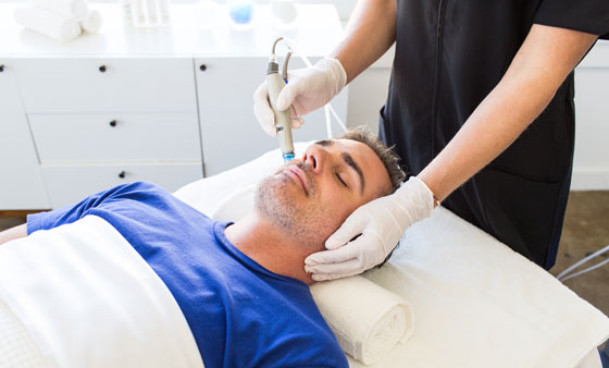 Man Receiving A Hydra Facial In Gainesville, FL