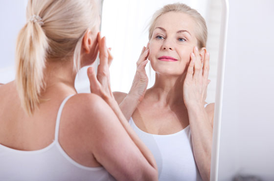 Senior Woman Admiring Her Skin After Micro Needling Therapy In Gainesville, FL