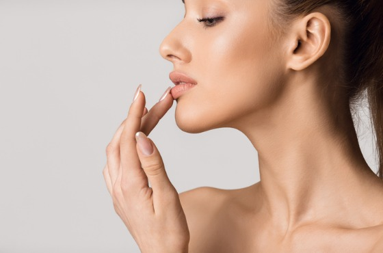 Woman Touching Lips After Receiving Lip Augmentation Treatments